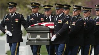 US troopers pass the casket of Korean Battle soldier US Military Sgt Wilson Meckley, Jr., for the period of his graveside ceremony at Arlington National Cemetery in Washington. Photo: April 2016