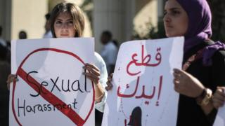 Egyptian women hold signs during a protest against sexual harassment in Cairo, Egypt, 14 June 2018