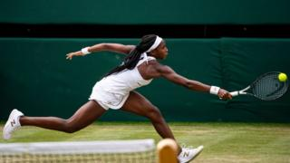cori gauff reaches for a ball