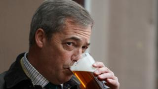 Nigel Farage drinks a pint of beer