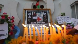 People in Herat light candles and hold placards to condemn the killing of a Spanish ICRC aid worker, 16 September 2017