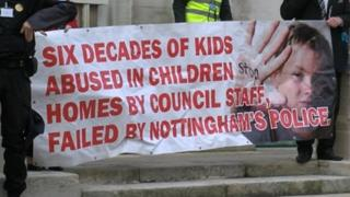 Campaigners unveiled a banner outside County Hall