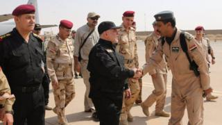 Twitter image of Haider al-Abadi shaking hands with Iraqi fighters