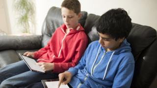 boys using blank tablets indoors