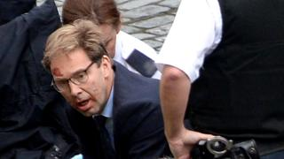 Tobias Ellwood giving CPR to PC Keith Palmer