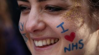 Woman with I love NHS written on her face