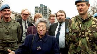 UN High Commissioner for Refugees Sadako Ogata (C) poses on the Fraternity Bridge 16 March 1994, Bosnia