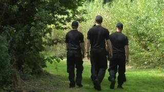 Police searching woodland