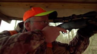 Man shooting a hunting rifle