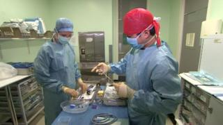 A surgeon from the US airbase (on the left) works with a British colleague