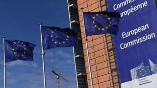 European Union flags next to the European Commission headquarters in Brussels