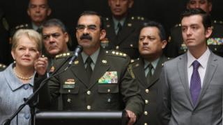 """Colombia""""s General Rodolfo Palomino, the head of the national police, accompanied by his wife and his children, speaks during a news conference in Bogota, Colombia, February 17, 201"""