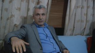Ali Mirzo sitting on a sofa