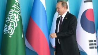 Russian president Vladimir Putin arrives for a G20 meeting in Turkey
