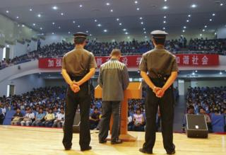 A young offender giving a speech at a school in China in May 2017