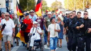 Hundreds of protesters took to the streets of Dresden when the chancellor visited on 16 August