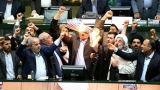 Iranian parliamentarians burn a US flag