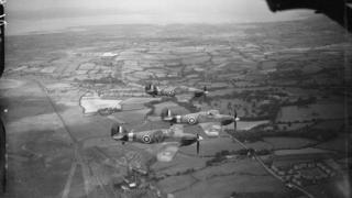 Three Hawker Hurricane Mark IIBs of No 79 Squadron RAF based at Fairwood Common during WW2 flying above south Wales