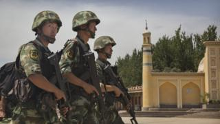 Chinese police on a past patrol in Xinjiang province