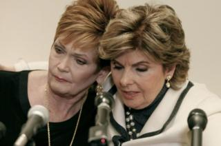 Ms Nelson (left) with her lawyer at a press conference on Friday