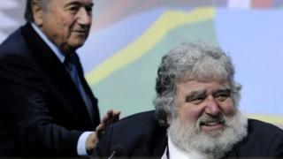 Fifa President Sepp Blatter (L) taps the shoulder of Chuck Blazer (R) in Zurich on 1 June 2011