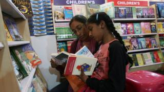 Woman and child in book shop