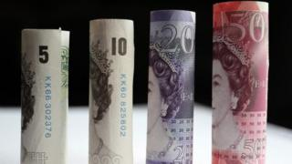 A range of bank notes from £5-£20
