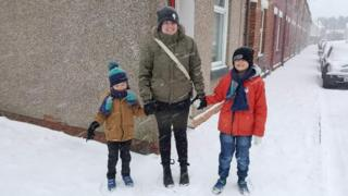 Kat with her sons in the snow