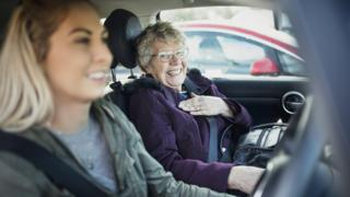 Older woman with younger woman in car
