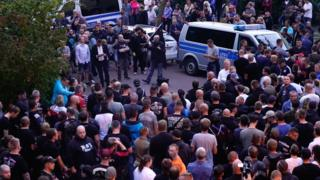 People gather in the German city of Köthen after a 22-year-old man died following a street fight, 9 September 2018