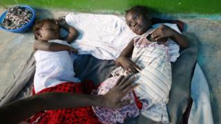 Two Haitian girls are treated for cholera