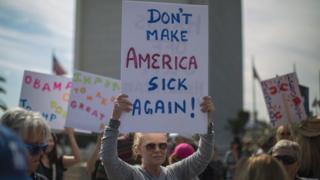 Demonstrators protest Donald Trump's policies that threaten the Affordable Care Act, Medicare and Medicaid, in Los Angeles, California, 25 January 2017