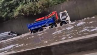 Screen grab from footage taken with permission from the Facebook page of Matt Hickmott of flash flooding on the M25, where it was also raining and hailing. PA Photo. Issue date: Thursday August 13, 2020.