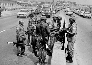"A photo by Sunmi Smart-Cole entitled: ""Never Again!"" (Muhammadu Buhari's coup) - 31 December 1983, armed Nigerian soldiers seen on the streets"
