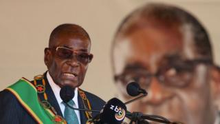 """Zimbabwean President Robert Mugabe addresses a rally to mark the country""""s 37th independence anniversary in Harare, Zimbabwe, April 18, 2017."""