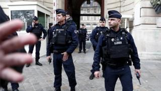French police and security forces stand outside Paris police headquarters on 3 October 2019.