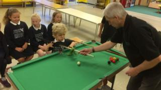 Pupils at Ysgol Cymerau in Pwllheli try out their new snooker table