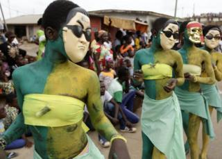 Ivoriens take part in a parade on the last day of the 36th Popo Carnival in Bonoua, 60km south of Abidjan, Ivory Coast, 29 April 2017 . The carnival of Bonoua is the Ivoirians version of Mardi Gras running for a week and is one of the most well attended events in the Ivory Coast. Derived from at first a celebration of the cultural heritage of the Aboure people, the Popo Carnival involves gastronomic competitions, Miss pageants, sports days, a festival of traditional dances and reflection workshops on Popo museum amongst other activities.