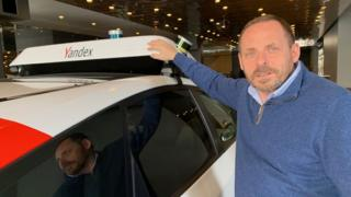 Yandex founder Arkady Volozh with one of the firm's self-driving cars