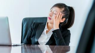 Woman falling asleep in meeting