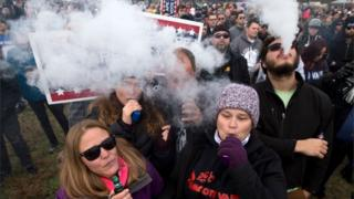Demonstrators vape during a consumer advocate groups and vape storeowners rally outside of the White House to protest the proposed vaping flavour ban in Washington DC on 9 November 2019.