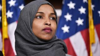 Congresswoman Ilhan Omar in front of US flag
