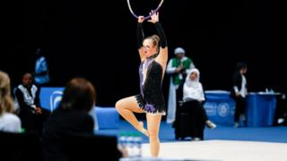 Athlete from Norway performs Rhythmic Gymnastics routine during Special Olympics World Games in Abu Dhabi