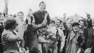 Fred Daly is held aloft by the crowds at Royal Liverpool