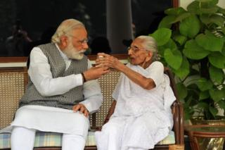 Prime Minister Narendra Modi with his mother Hiraba at the 7RCR in New Delhi during the latter's first visit to the PM's residence.