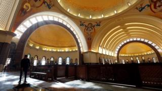 A worker cleans the interior of the new Coptic Cathedral of the Nativity at the New Administrative Capital