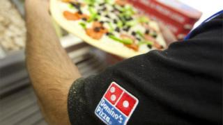 Domino's Pizza being made