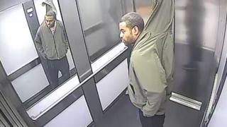 Man stealing a Venetian blind