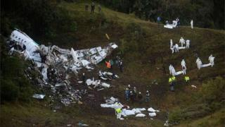 This file photo taken on November 29, 2016 shows rescuers searching for survivors from the wreckage of the LAMIA airlines charter plane carrying members of the Chapecoense Real football team that crashed in the mountains of Cerro Gordo, municipality of La Union, on November 29, 2016.