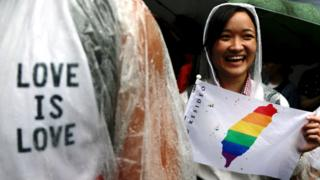 Supporters of same-sex marriage gather outside the parliament building as a bill for marriage equality is debated by parliamentarians in Taipei, Taiwan, 17 May 2019.